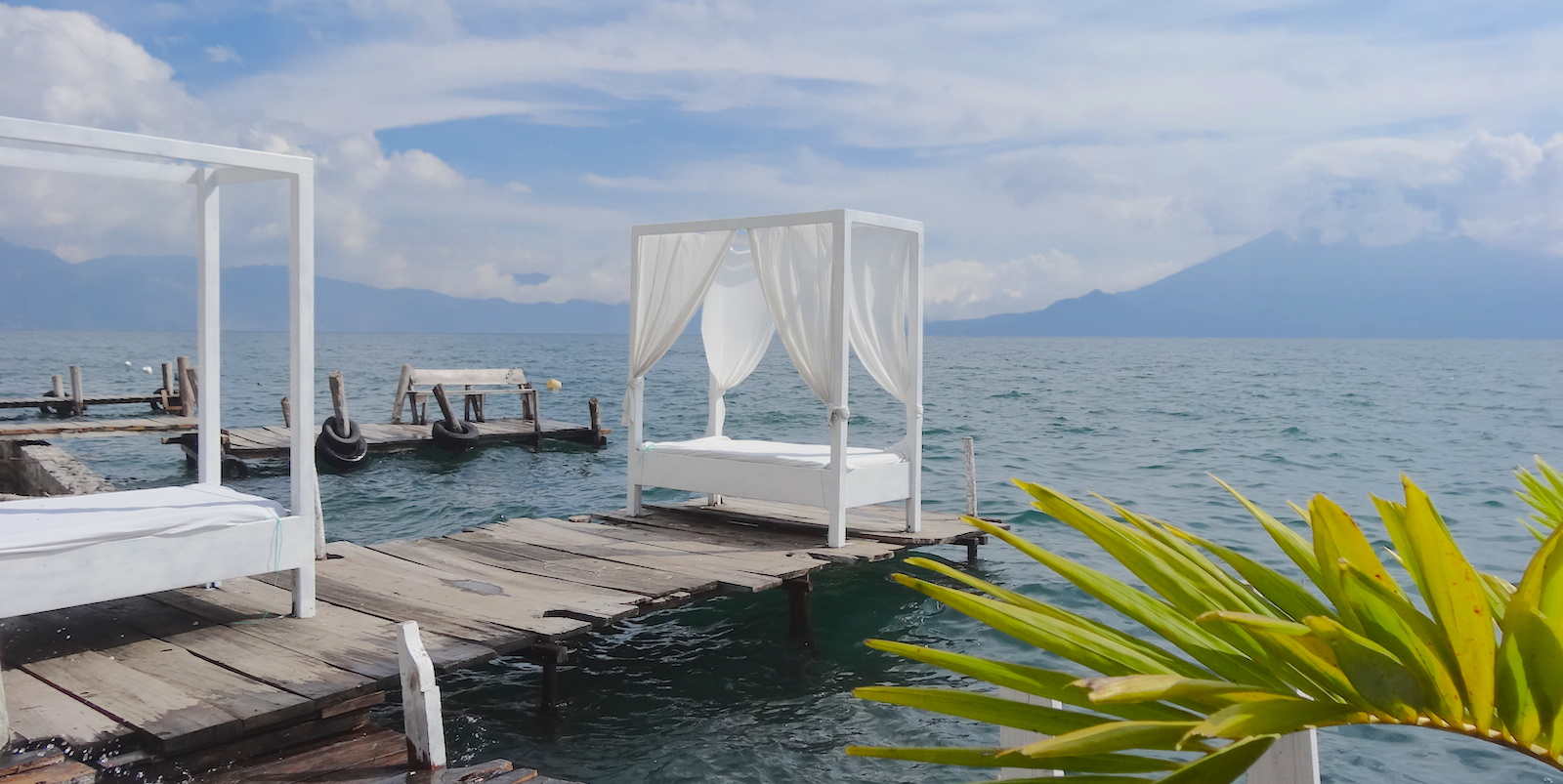 white bed on dock in santa cruz lake atitlan