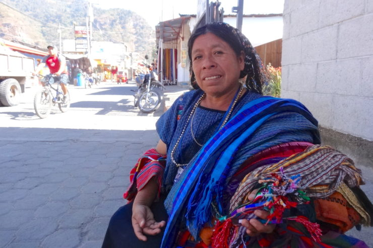 Maya-woman-selling-textiles-in-Guatemala