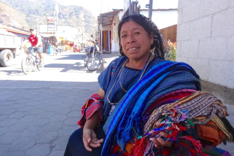Maya-woman-selling-textiles-in-Guatemala